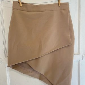ASYMMETRICAL NUDE SKIRT